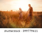 the couple go on a field at...   Shutterstock . vector #399779611