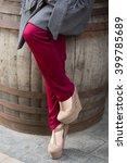 Female Legs Wearing Beige Shoe...