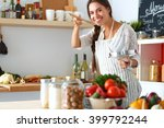 Cooking Woman In Kitchen With...
