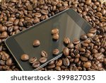 phone and coffee beans on the... | Shutterstock . vector #399827035