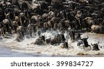 wildebeests are crossing mara... | Shutterstock . vector #399834727