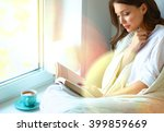 young woman at home sitting... | Shutterstock . vector #399859669