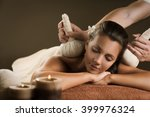 massage with herbal balls.... | Shutterstock . vector #399976324