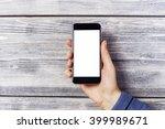 blank white smartphone held by... | Shutterstock . vector #399989671