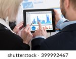 two businesspeople analyzing... | Shutterstock . vector #399992467