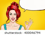 Stock photo pop art winking woman showing ok sign with speech bubble party invitation or birthday greeting 400046794