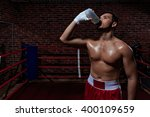 drinking young man indoors | Shutterstock . vector #400109659