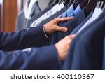 male hand choosing a shirt | Shutterstock . vector #400110367