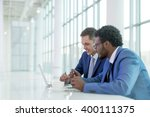 business people at meeting in... | Shutterstock . vector #400111375