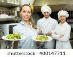 beautiful young female waiter... | Shutterstock . vector #400147711