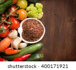 uncooked red rice in a bowl... | Shutterstock . vector #400171921