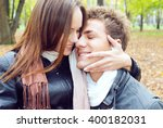young and happy couple on the... | Shutterstock . vector #400182031
