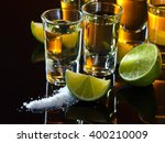 tequila and lime on a black... | Shutterstock . vector #400210009