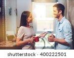 nice coffee break. two cheerful ... | Shutterstock . vector #400222501
