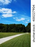 A Path In A Grassy Area With...