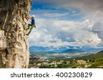 young male climber hanging by a ... | Shutterstock . vector #400230829