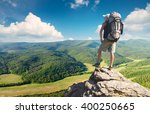 tourist on the peak of high... | Shutterstock . vector #400250665