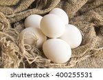 close up white eggs on a brown... | Shutterstock . vector #400255531