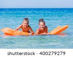 kids playing in sea.  | Shutterstock . vector #400279279