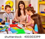 children with teacher woman... | Shutterstock . vector #400303399