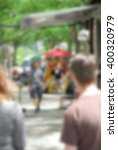 Small photo of A hot dog stand in the city - blurred - ideal for non obtrusive backgrounds