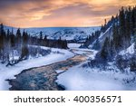 Small photo of A dramatic sunset illuminates the clear waters of Phelan Creek in early spring in the Alaska Range
