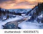 a dramatic sunset illuminates... | Shutterstock . vector #400356571
