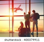 happy family with suitcases in... | Shutterstock . vector #400379911