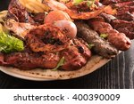 mixed grilled meat and... | Shutterstock . vector #400390009