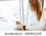 girl wearing white sweater ... | Shutterstock . vector #400401139