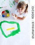 a cute young girl painting a...   Shutterstock . vector #4004143