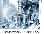 open dishwasher with clean... | Shutterstock . vector #400443229