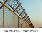 rusty barbed wire fence in... | Shutterstock . vector #400459204