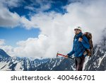 mountaineer with ice ax reaches ... | Shutterstock . vector #400466701