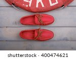 Red Boat Shoes With Orange...