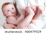 the baby in diapers eating... | Shutterstock . vector #400479529