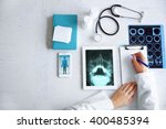 doctor using his tablet pc ... | Shutterstock . vector #400485394