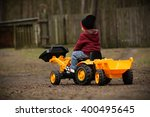 Boy On A Toy Tractor