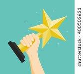 the winner  hand holding winner'...   Shutterstock .eps vector #400503631