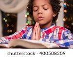 afro child praying. black kid... | Shutterstock . vector #400508209