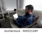 young bearded man lying on the... | Shutterstock . vector #400521289