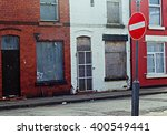 A Street Of Boarded Up Derelic...