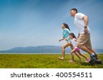 asian family running on open... | Shutterstock . vector #400554511