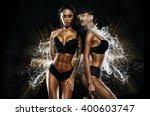 sexy twins in water splash   Shutterstock . vector #400603747