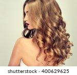 beautiful girl with long wavy... | Shutterstock . vector #400629625