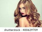 beautiful girl with long wavy... | Shutterstock . vector #400629709