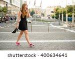 teenager on the phone walking... | Shutterstock . vector #400634641