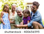 smiling father taking selfie... | Shutterstock . vector #400656595