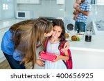 mother kissing girl holding...   Shutterstock . vector #400656925