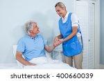 smiling nurse holding senior